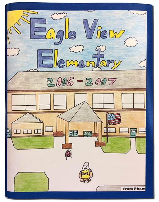 The cover of Eagle View Elementary School's first yearbook. It features a picture of the front of the school drawn by student Tram Pham.