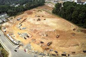 Aerial photograph of construction progress of Eagle View Elementary School, taken on June 29, 2005. The ground has been cleared and construction vehicles are present.