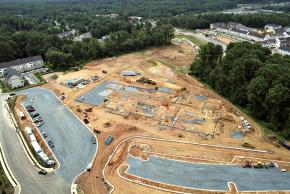 Aerial photograph of construction progress of Eagle View Elementary School, taken on July 28, 2005. The concrete foundation has been poured in sections of the building. The general cinderblock layout is present.