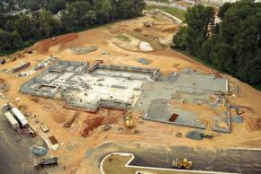 Aerial photograph of construction progress of Eagle View Elementary School, taken on August 26, 2005. Nearly all of the concrete foundation has been poured and walls are beginning to go up on the south side of the building.