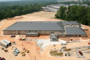 Aerial photograph of construction progress of Eagle View Elementary School, taken on May 31, 2006. The exterior of the building looks complete. Concrete sidewalks are being paved. The landscape is still earth and has not been sodded.
